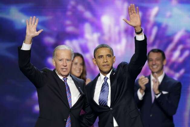 Vice President Joe Biden and President Barack Obama wave to the delegates at the conclusion of Presdident Obama's speech at the Democratic National Convention in Charlotte, N.C., on Thursday, Sept. 6, 2012. (AP Photo/J. Scott Applewhite) (Associated Press)