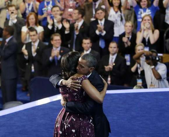 President Barack Obama hugs his wife first lady Michelle Obama on stage at the Democratic National Convention in Charlotte, N.C., Thursday, Sept. 6, 2012. (AP Photo/Pablo Martinez Monsivais) (Associated Press)