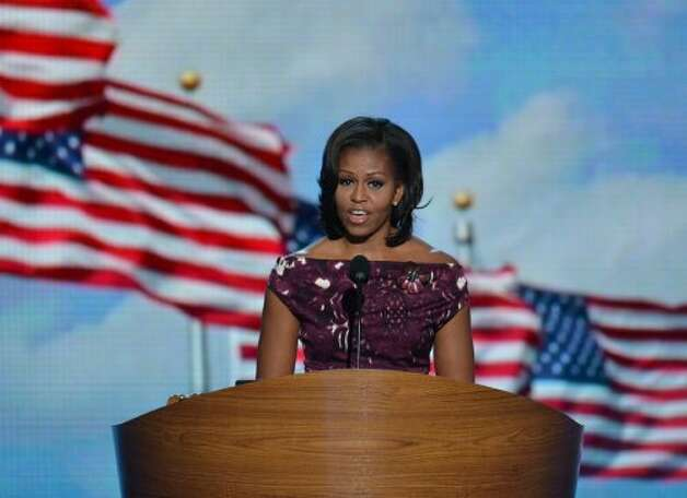 First Lady Michelle Obama introduces her husband US President Barack Obama as he is to deliver his acceptance speech to run for a second term as president at the Time Warner Cable Arena in Charlotte, North Carolina, on September 6, 2012 on the final day of the Democratic National Convention (DNC).   AFP PHOTO  Stan HONDASTAN HONDA/AFP/GettyImages (AFP/Getty Images)
