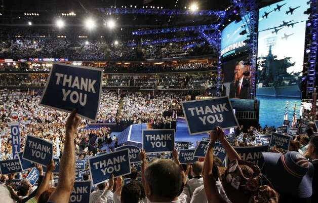 Delegates hold up signs during Ret. Navy Admiral John B. Nathman's speech at the Democratic National Convention in Charlotte, N.C., on Thursday, Sept. 6, 2012. (AP Photo/Lynne Sladky) (Associated Press)