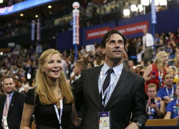 Actors Jennifer Westfeldt and Jon Hamm are seen on the floor at the Democratic National Convention in Charlotte, N.C., on Thursday, Sept. 6, 2012. (AP Photo/Charles Dharapak) (Associated Press)