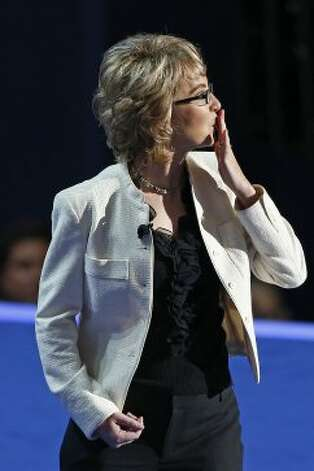 Former Rep. Gabrielle Giffords of Arizonia blows a kiss after reciting the Pledge of Allegiance the Democratic National Convention in Charlotte, N.C., on Thursday, Sept. 6, 2012. (AP Photo/Carolyn Kaster) (Associated Press)