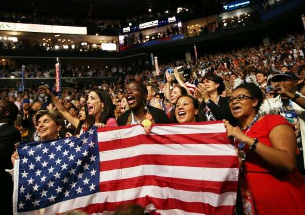 CHARLOTTE, NC - SEPTEMBER 06:  People hold an American flag during the final day of the Democratic National Convention at Time Warner Cable Arena on September 6, 2012 in Charlotte, North Carolina. The DNC, which concludes today, nominated U.S. President Barack Obama as the Democratic presidential candidate.  (Photo by Tom Pennington/Getty Images) (Getty Images)