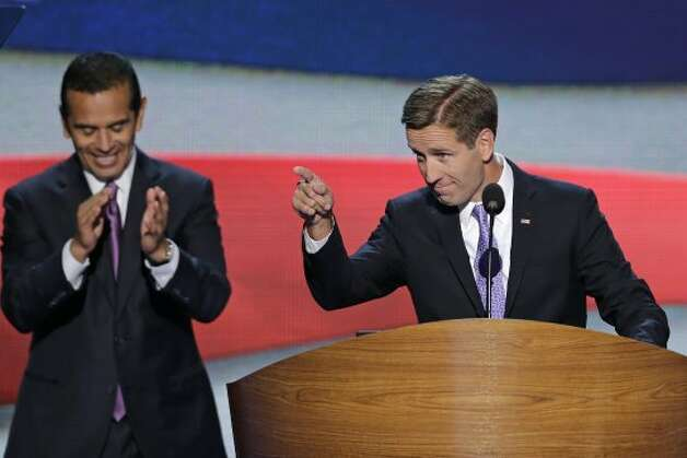 Beau Biden, Attorney General of Delaware and son of Vice President Joe Biden points towards the delegates before his nominates his father during the Democratic National Convention in Charlotte, N.C., on Thursday, Sept. 6, 2012. Los Angeles Mayor and Democratic Convention Chairman Antonio Villaraigosa claps in the background.  (J. Scott Applewhite / Associated Press)