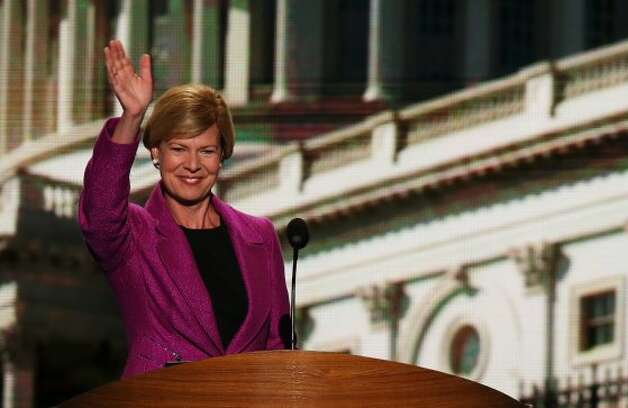 CHARLOTTE, NC - SEPTEMBER 06:  U.S. Rep. Tammy Baldwin (D-WI) waves on stage during the final day of the Democratic National Convention at Time Warner Cable Arena on September 6, 2012 in Charlotte, North Carolina. The DNC, which concludes today, nominated U.S. President Barack Obama as the Democratic presidential candidate.   (Alex Wong / Getty Images)