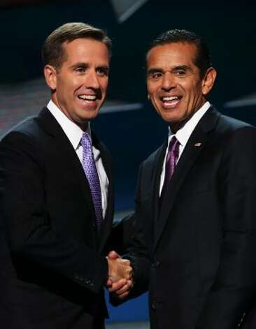 CHARLOTTE, NC - SEPTEMBER 06:  Attorney General of Delaware Beau Biden (L) shakes hands with DNC Chair Los Angeles Mayor Antonio Villaraigosa during the final day of the Democratic National Convention at Time Warner Cable Arena on September 6, 2012 in Charlotte, North Carolina. The DNC, which concludes today, nominated U.S. President Barack Obama as the Democratic presidential candidate.   (Chip Somodevilla / Getty Images)