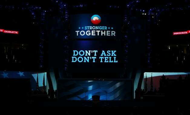 "CHARLOTTE, NC - SEPTEMBER 06:  A display on stage reads ""Don't Ask Don't Tell"" during the final day of the Democratic National Convention at Time Warner Cable Arena on September 6, 2012 in Charlotte, North Carolina. The DNC, which concludes today, nominated U.S. President Barack Obama as the Democratic presidential candidate.   (Alex Wong / Getty Images)"