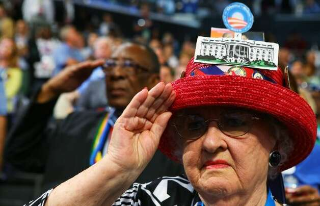 CHARLOTTE, NC - SEPTEMBER 06:  A woman salutes during the final day of the Democratic National Convention at Time Warner Cable Arena on September 6, 2012 in Charlotte, North Carolina. The DNC, which concludes today, nominated U.S. President Barack Obama as the Democratic presidential candidate.   (Joe Raedle / Getty Images)