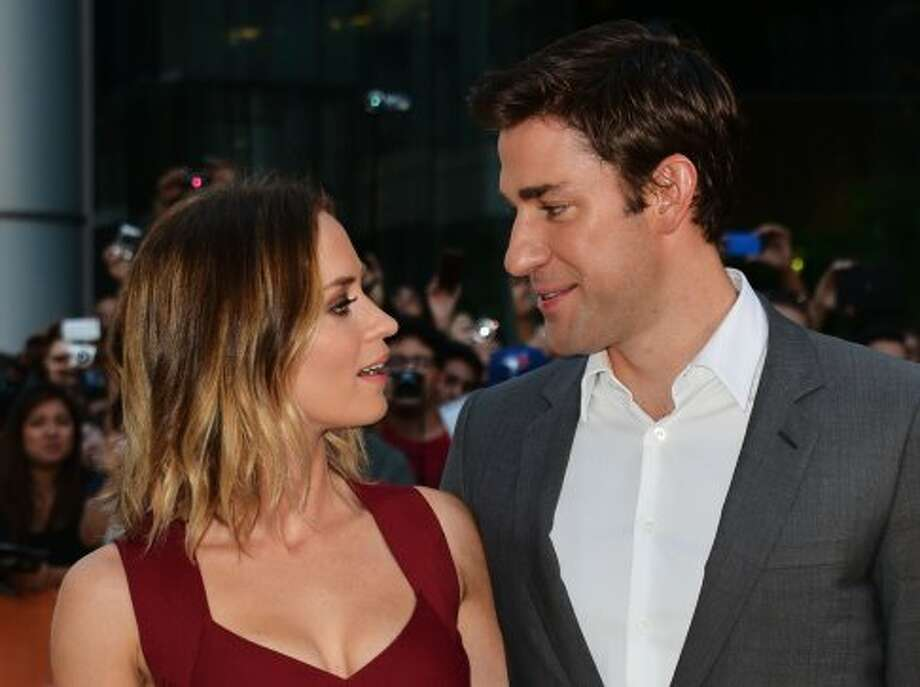 "Emily Blunt and husband and actor John Krasinski attend the ""Looper"" premiere during the 2012 Toronto International Film Festival.  (Alberto E. Rodriguez / Getty Images)"
