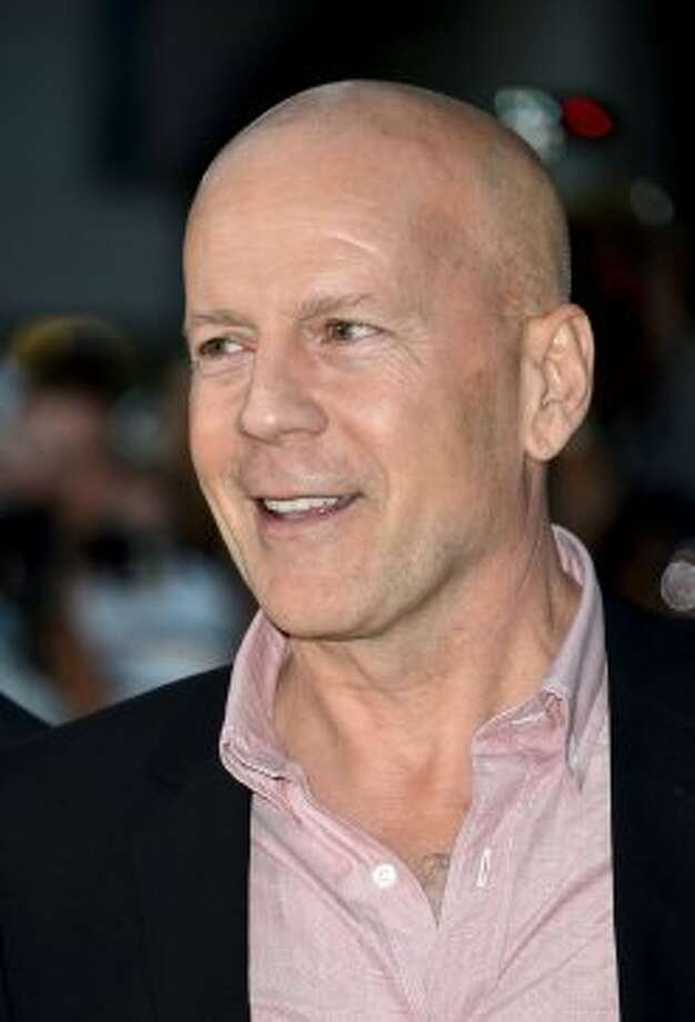 "Bruce Willis attends the ""Looper"" premiere during the 2012 Toronto International Film Festival.  (Alberto E. Rodriguez / Getty Images)"