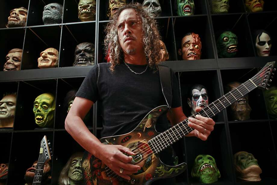Metallica guitarist Kirk Hammett, with latex masks, is releasing a book in October about his huge horror collection. Photo: Russell Yip, The Chronicle