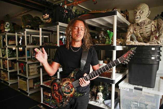 "Kirk Lee Hammett, guitarist for Metallica and longtime horror film fanatic, is coming out with a book, ""Too Much Horror Business - The Kirk Hammett Collection.""  Hammett is seen with part of his horror film collection in his San Francisco home. Photo: Russell Yip, The Chronicle"