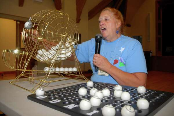 Betty McOsker, director of the The Over Sixty Club, calls bingo numbers at their new location at St. John's Episcopal Church on Friday September 7, 2012.