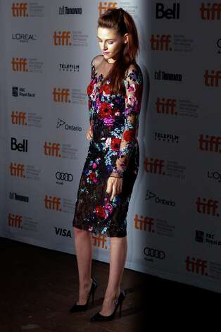 "Kristen Stewart is shown on the red carpet at the gala premiere for the movie ""On the Road"" during the 2012 Toronto International Film Festival in Toronto on Thursday, Sept. 6, 2012. (AP Photo/The Canadian Press, Chris Young) Photo: Chris Young"
