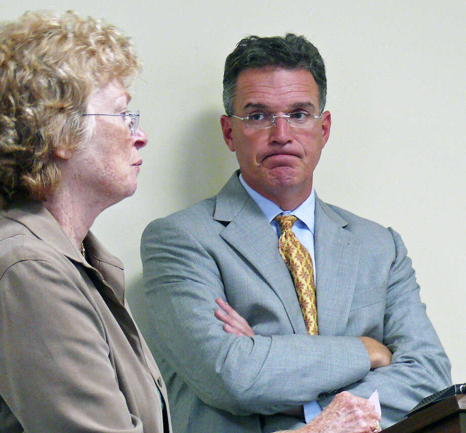 Human Resources Director Mary Caroll Mirylees, left, and labor attorney Patrick McHale, outline the new contract with public health nurses to the Board of Selectmen. Photo: Genevieve Reilly / Fairfield Citizen