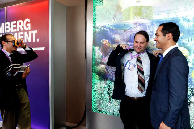 "Scott Crass, of New Jersey, puts on his jacket to have a picture taken with Mayor Julian Castro, who he called, ""the future President,"" after Castro participated in a Bloomberg-Google Inc. panel discussion about the potential impact of technology on jobs with the mayors of Charlotte, NC, Houston, and San Francisco, CA at the Democratic National Convention in Charlotte, NC on Thursday, Sept. 6, 2012. Photo: Lisa Krantz, San Antonio Express-News / San Antonio Express-News"