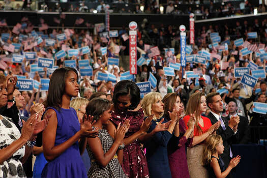First Lady Michelle Obama, with her daughters, Malia, far left, Sasha, Jill Biden and other family members, applaud for President Barack Obama on the final night of the Democratic National Convention at Time Warner Cable Arena in Charlotte, NC on Thursday, Sept. 6, 2012. Photo: Lisa Krantz, San Antonio Express-News / San Antonio Express-News