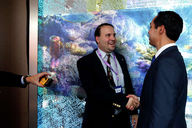 "Scott Crass, of New Jersey, left, shakes hands with Mayor Julian Castro, who he called, ""the future President,"" after Castro participated in a Bloomberg-Google Inc. panel discussion about the potential impact of technology on jobs with the mayors of Charlotte, NC, Houston, and San Francisco, CA at the Democratic National Convention in Charlotte, NC on Thursday, Sept. 6, 2012. Photo: Lisa Krantz, San Antonio Express-News / San Antonio Express-News"