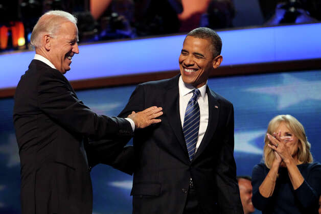 President Barack Obama and Vice President Joe Biden laugh after their embrace next to Jill Biden at the conclusion of the Democratic National Convention at Time Warner Cable Arena in Charlotte, NC on Thursday, Sept. 6, 2012. Photo: Lisa Krantz, San Antonio Express-News / San Antonio Express-News