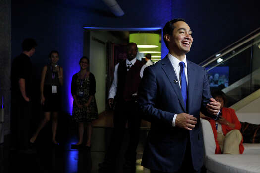 Mayor Julian Castro does interview an interview with Bloomberg News as MC Hammer waits to talk to him after participating in a Bloomberg-Google Inc. panel disscusson about the potential impact of technology on jobs with the mayors of Charlotte, NC, Houston, and San Francisco, CA at the Democratic National Convention in Charlotte, NC on Thursday, Sept. 6, 2012. Photo: Lisa Krantz, San Antonio Express-News / San Antonio Express-News