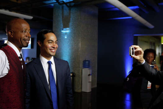 Mayor Julian Castro poses for a picture with MC Hammer after Castro participated in a Bloomberg-Google Inc. panel disscusson about the potential impact of technology on jobs with the mayors of Charlotte, NC, Houston, and San Francisco, CA at the Democratic National Convention in Charlotte, NC on Thursday, Sept. 6, 2012. Photo: Lisa Krantz, San Antonio Express-News / San Antonio Express-News