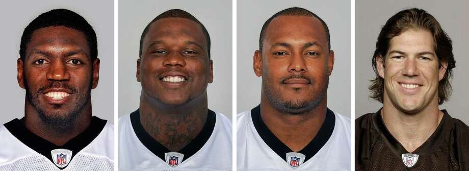 FILE - From left are NFL football players Jonathan Vilma, in 2011; Anthony Hargrove, in 2010; Will Smith, in 2011; and Scott Fujita, in 2011. The suspensions of four players in the NFL's bounty investigation have been lifted by a three-member appeals panel. The league reinstated those players a few minutes after Friday's, Sept. 7, 2012 ruling. While the ruling allows Saints linebacker Jonathan Vilma, Saints defensive end Will Smith, Cleveland linebacker Scott Fujita and free agent defensive lineman Anthony Hargrove to play immediately, it does not permanently void their suspensions (AP Photo/File) Photo: Uncredited, FRE / AP
