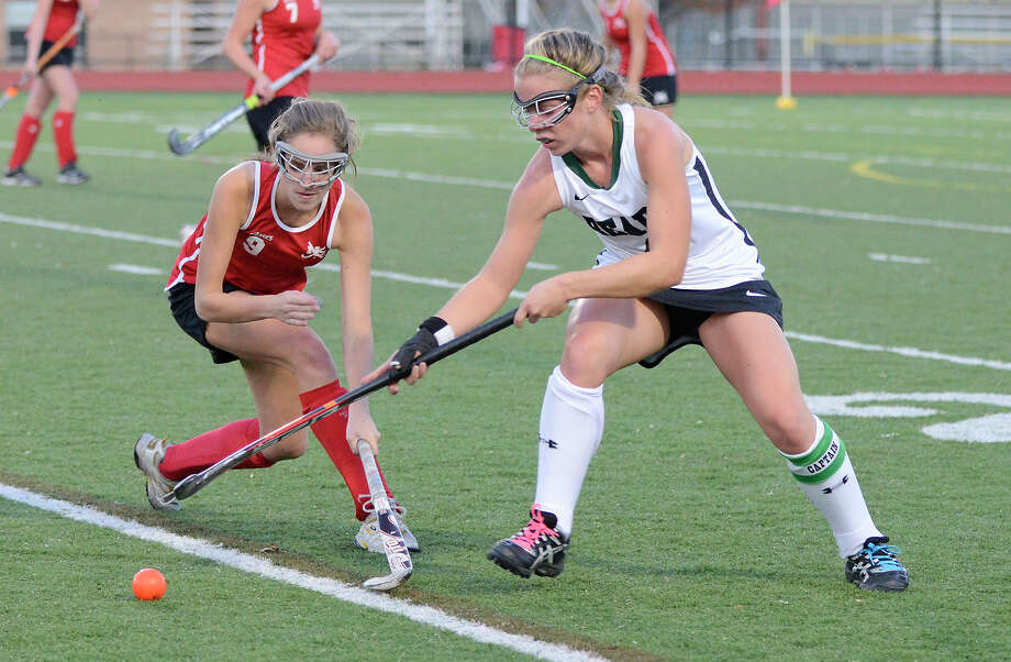 New Canaan's Bridget Falcone and Norwalk's Christine Mace vie for the ball as Norwalk High School challenges New Canaan High School in field hockey at Fairfield Warde High School in Fairfield, CT on Weds., Nov. 2, 2011. Photo: Shelley Cryan / Shelley Cryan freelance; Connecticut Post freelance