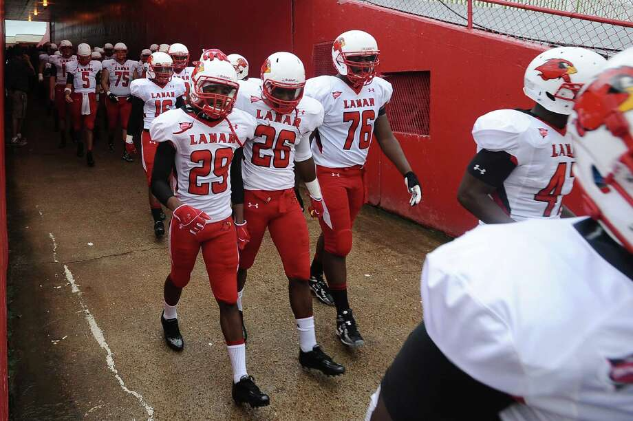 Adrian Guillory, Chad Allen, and Justin Brock enter in the Ragin' Cajuns stadium in Lafayette on Saturday, September 1, 2012. Photo taken: Randy Edwards/The Enterprise Photo: Randy Edwards, Photojournalist / Enterprise