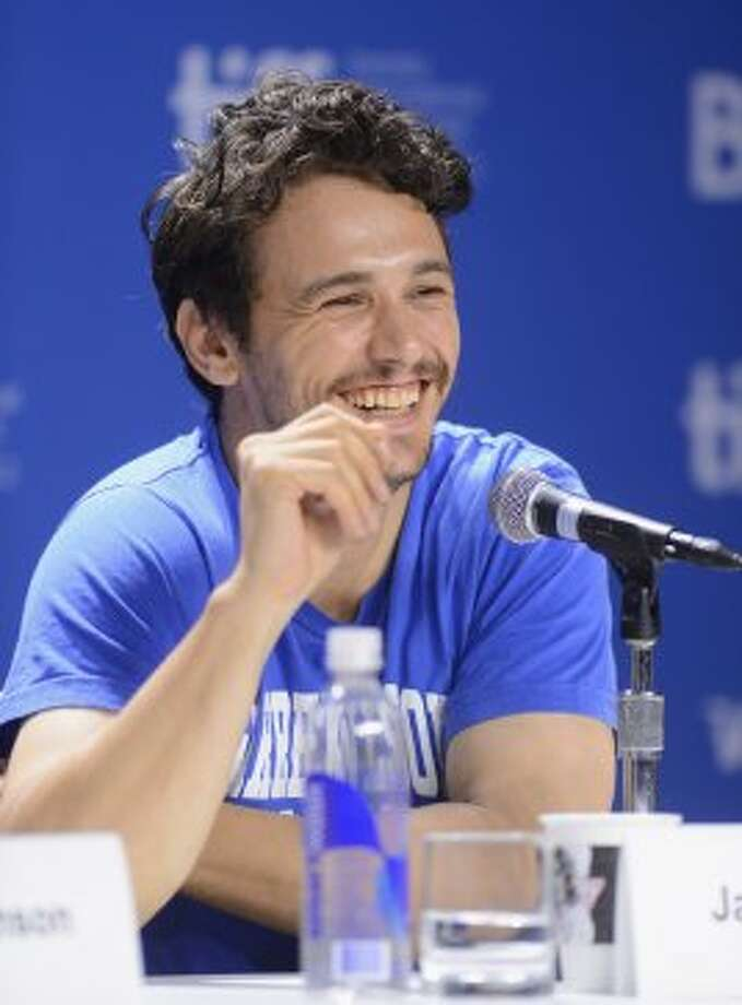"James Franco speaks at the ""Spring Breakers"" press conference at the 2012 Toronto International Film Festival. (Jason Merritt / Getty Images)"