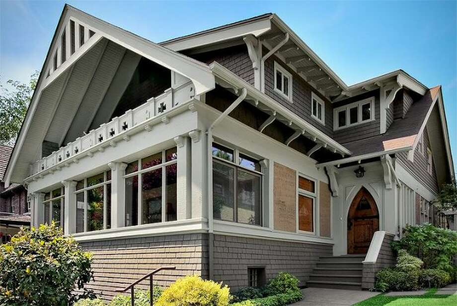 Looking for an Arts and Crafts home with space and distinctive character in Denny Blaine? Check out 143 Madrona Place East. The 5,100-square-foot house, built in 1905, has five bedrooms and 4.25 bathrooms -- including a separate lower-level apartment -- exposed-wood doors, paneling, moldings and beams, leaded glass, a solarium, a balcony off the master bedroom, a patio and a two-car garage on a 9,695-square-foot lot. It's listed for $2.425 million. Photo: Courtesy Pam Johnson/Windermere Real Estate