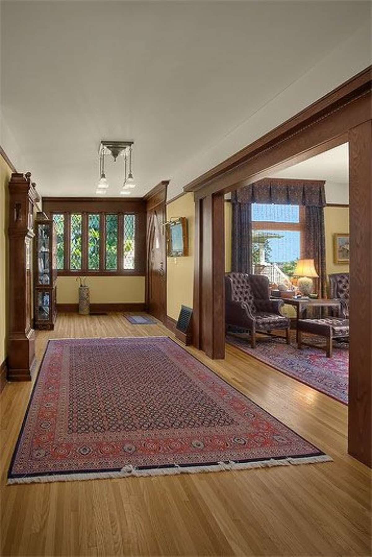 Foyer of 143 Madrona Place East. The 5,100-square-foot house, built in 1905, has five bedrooms and 4.25 bathrooms -- including a separate lower-level apartment -- exposed-wood doors, paneling, moldings and beams, leaded glass, a solarium, a balcony off the master bedroom and a patio on a 9,695-square-foot lot. It's listed for $2.425 million.