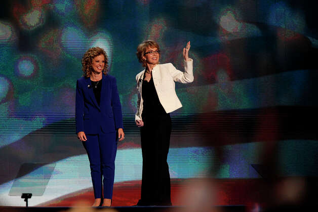 Former U.S. Representative Gabrielle Giffords, of Arizona, right, with Debbie Wasserman Schultz, Chair of the Democratic National Committee, blows kisses to delegates after leading the Pledge of Allegiance on the final night of the Democratic National Convention at Time Warner Cable Arena in Charlotte, NC on Thursday, Sept. 6, 2012. Photo: Lisa Krantz, San Antonio Express-News / San Antonio Express-News