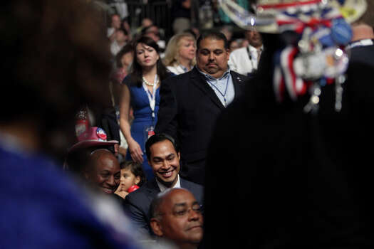 Mayor Julian Castro visits with the Texas delegates on the final night of the Democratic National Convention at Time Warner Cable Arena in Charlotte, NC on Thursday, Sept. 6, 2012. Photo: Lisa Krantz, San Antonio Express-News / San Antonio Express-News