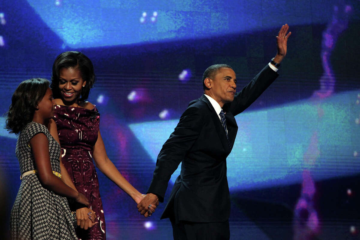 President Barack Obama leaves the stage with his family including First Lady Michelle Obama and their daughter, Sasha, at the conclusion of the Democratic National Convention at Time Warner Cable Arena in Charlotte, NC on Thursday, Sept. 6, 2012.