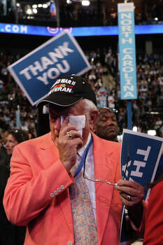 World War II Veteran Charles Johnson, of Rocky Mount, NC, wipes his tears after a tribute to the military on the final night of the Democratic National Convention at Time Warner Cable Arena in Charlotte, NC on Thursday, Sept. 6, 2012. Photo: Lisa Krantz, San Antonio Express-News / San Antonio Express-News