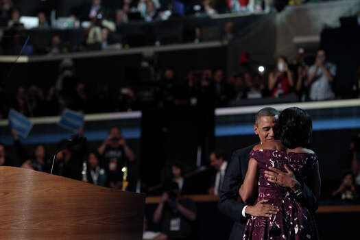 First Lady Michelle Obama embraces her husband, President Barack Obama, after introducing him on the final night of the Democratic National Convention at Time Warner Cable Arena in Charlotte, NC on Thursday, Sept. 6, 2012. Photo: Lisa Krantz, San Antonio Express-News / San Antonio Express-News