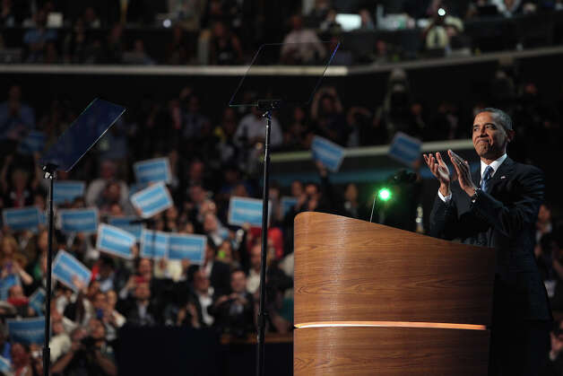 President Barack Obama responds to applause as he takes the podium for his speech on the final night of the Democratic National Convention at Time Warner Cable Arena in Charlotte, NC on Thursday, Sept. 6, 2012. Photo: Lisa Krantz, San Antonio Express-News / San Antonio Express-News