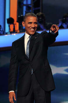 President Barack Obama acknowledges the audience after his speech  on the final night of the Democratic National Convention at Time Warner Cable Arena in Charlotte, NC on Thursday, Sept. 6, 2012. Photo: Lisa Krantz, San Antonio Express-News / San Antonio Express-News