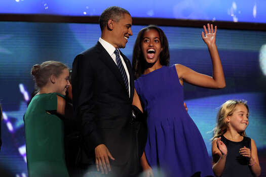 Malia Obama, right, waves with her father, President Barack Obama, on stage after the President's speech to conclude the Democratic National Convention at Time Warner Cable Arena in Charlotte, NC on Thursday, Sept. 6, 2012. Photo: Lisa Krantz, San Antonio Express-News / San Antonio Express-News