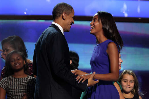 Malia Obama, right, shares a laugh with her father, President Barack Obama, on stage after the President's speech to conclude the Democratic National Convention at Time Warner Cable Arena in Charlotte, NC on Thursday, Sept. 6, 2012. Photo: Lisa Krantz, San Antonio Express-News / San Antonio Express-News