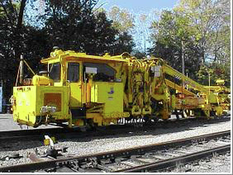 The New Canaan train station will be shut down during weekday off-peak hours during September. This machine will assist workers in the removal and replacement of ties and ballast during the track maintenance. Photo: Tyler Woods