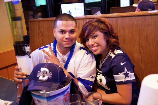 Alfredo Vallejo Jr. and Lorena Gallegos at Big Sam's grill and bar. Photo: Xelina Flores-Chasnoff, For The Express-News