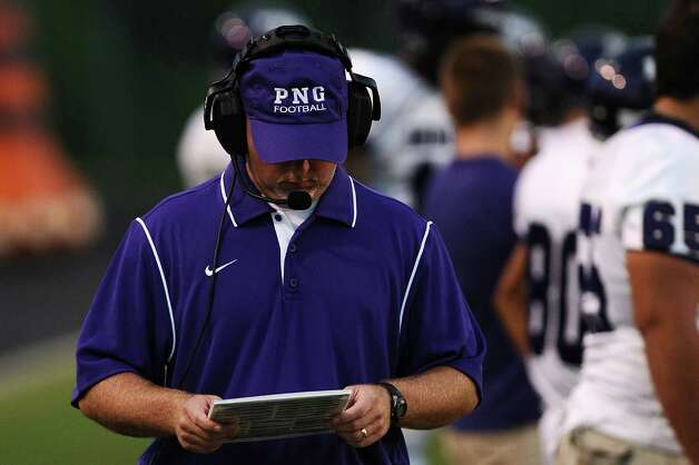 PNG Indians play calling method against the Silsbee Tigers at Silsbee High School on Friday, August 31, 2012. Photo taken: Randy Edwards/The Enterprise