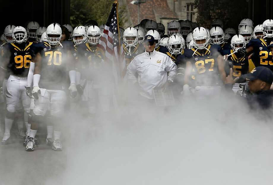 Against Nevada, Cal was a uniform mess, from ugly white helmets that bucked tradition to a bit of smoke-and-mirrors from coach Jeff Tedford (center) over who started at quarterback. Photo: Michael Macor, The Chronicle
