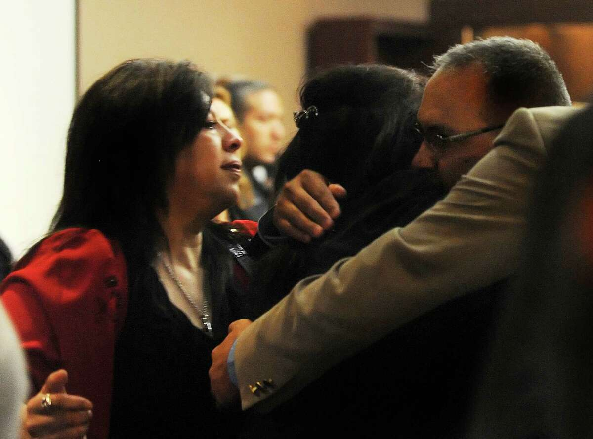 Gilbert John Sullaway Jr. (right) embraces his family after being found not guilty of criminally negligent homicide in the 2009 deaths of Gregory Bruehler and his wife, Alexandra.