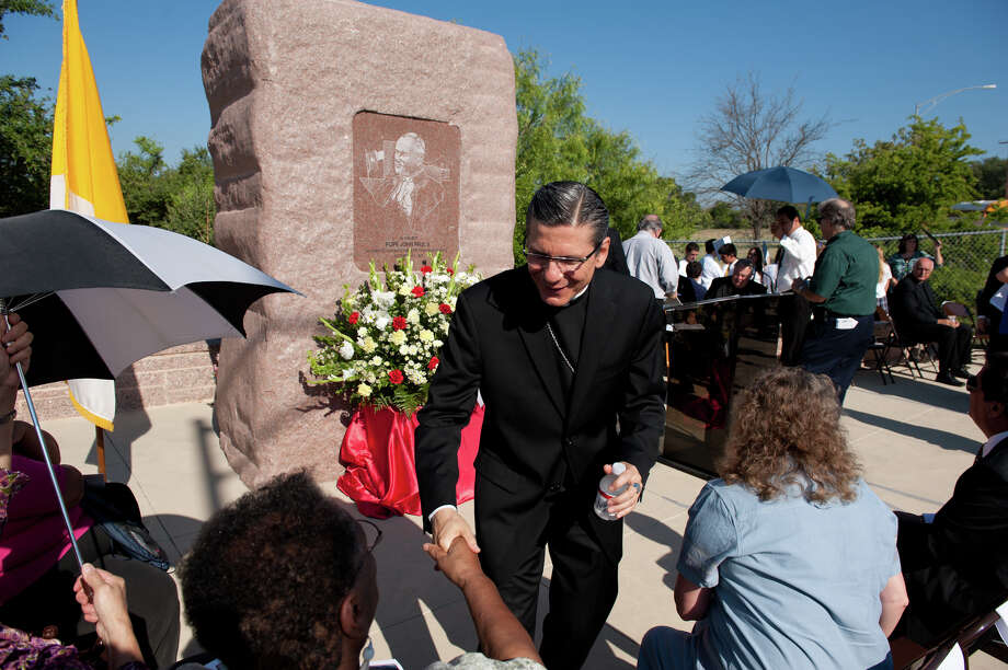 Archbishop Gustavo García-Siller greets spectators before the ceremony commemorating the anniversary. The Blessed John Paul II Monument is near the corner of Potranco and Dugas adjacent to Stevens High School. Photo: Robin Jerstad, For The Express-News