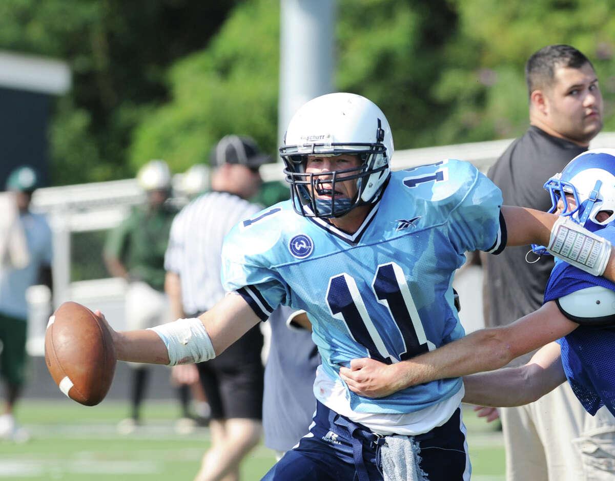 Quarterback Brett Phillips # 11 of Wilton during the high School football jamboree at Wilton High School, Saturday morning, Sept. 1, 2012.