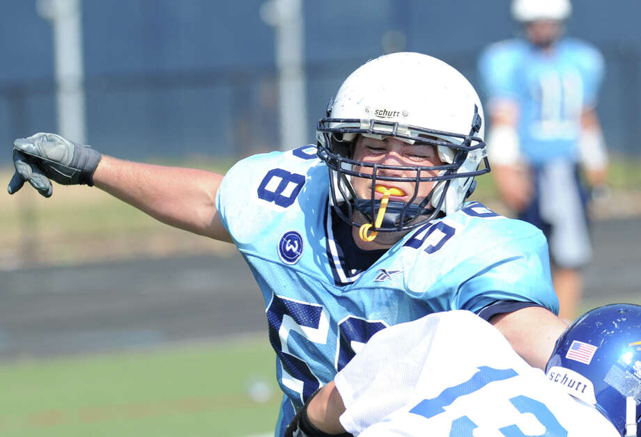 Wilton's Mike LaSala # 58 makes a tackle in scrimmage against Brookfield High School during the high School football jamboree at Wilton High School, Saturday morning, Sept. 1, 2012. Photo: Bob Luckey / Greenwich Time