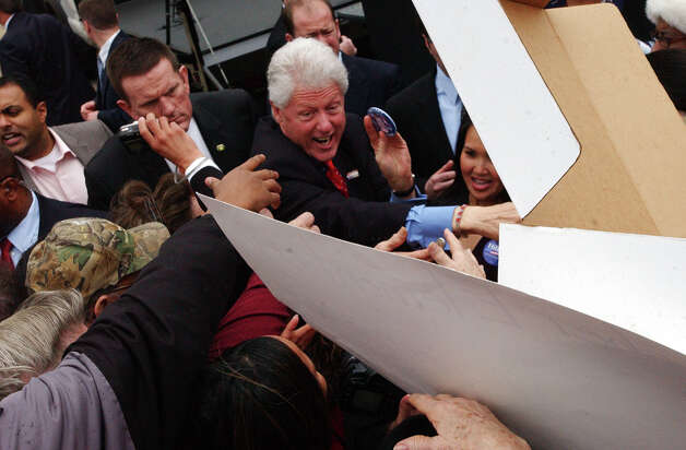 Bill Clinton reaches out  to shake hands with guests at a rally in downtown Beaumont on Wednesday. Campaigning for his wife Hillary Clinton, the former president also spoke to Hispanic city leaders in a private meeting prior to the rally. February 20, 2008 Photo by Guiseppe Barranco
