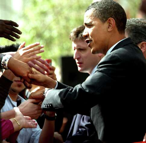 Presidental candidate, Senator Barack Obama shakes hands with the overflow crowd outside at the Julie Rogers Theater in Beaumont, TX Thursday, February 28, 2008. Beaumont Enterprise, Tammy McKinley Photo: TAMMY MCKINLEY